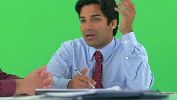 Thumbnail for businessmen working at desk on greenscreen