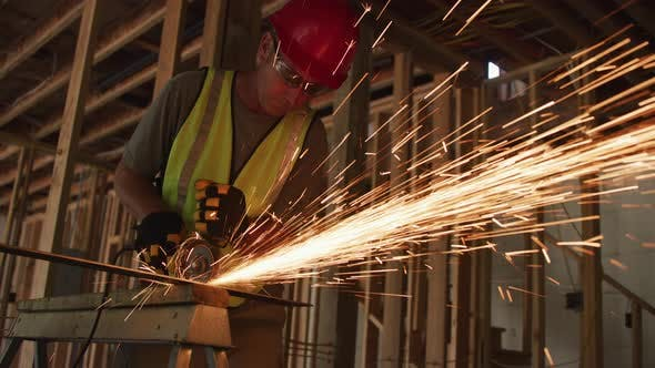 Thumbnail for Construction worker grinding metal and making sparks
