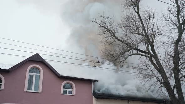 Burning Roof with Heavy Smoke in Residential House