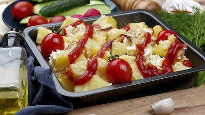 Baked Potatoes on a Baking Sheet with Tomatoes and Cheese