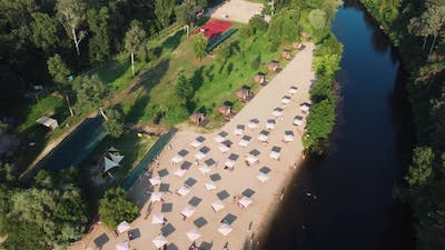Aerial Top View of River Sand Beach with Lounges and Umbrellas