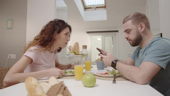 Thumbnail for Husband Sending Messages on Smartphone during Meal and Wife Grabbing It