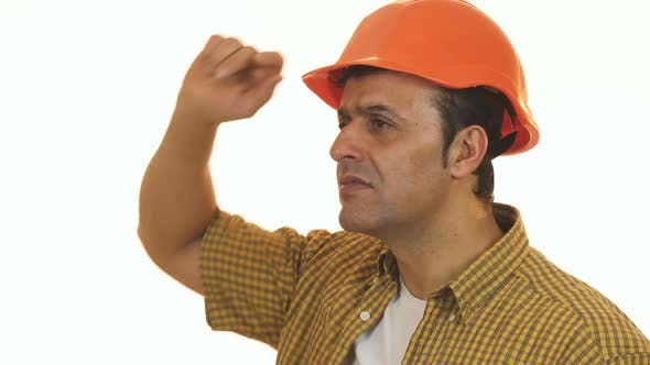 Thumbnail for Mature Professional Builder in Hardhat Looking Disappointed