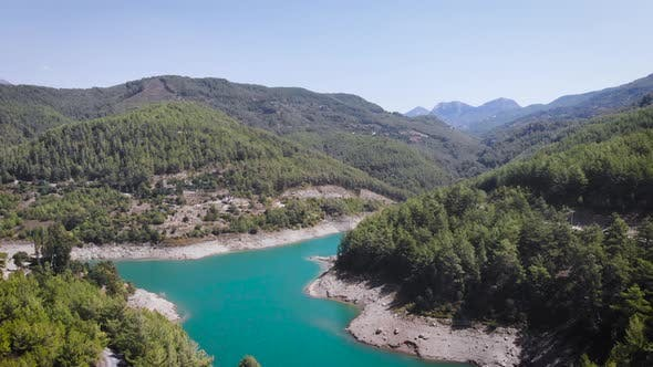 Aerial view of a mountain river in a valley between mountains in summer