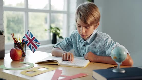 Boy Studying English in Classroom