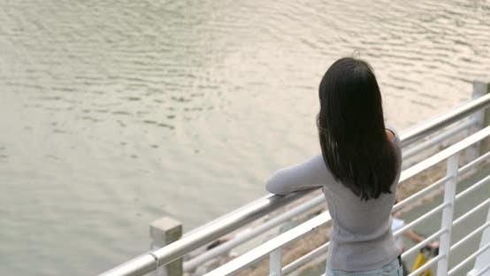 Woman enjoy the view at lakeside