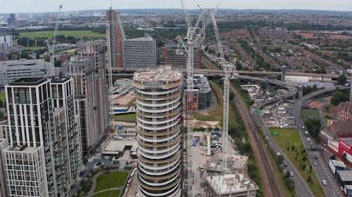 Tilt and Pan Shot of Modern Design Tall Building Construction Site