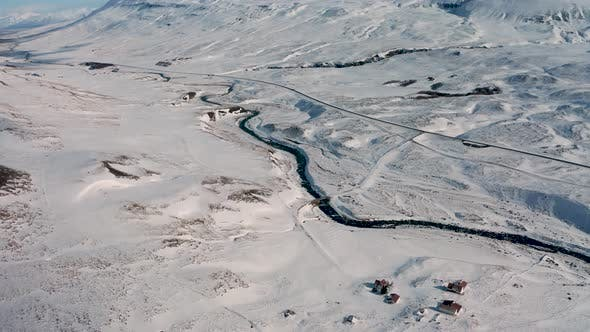 Thumbnail for Aerial View of a Winding Road Among the Snowy Mountains in the North of Iceland