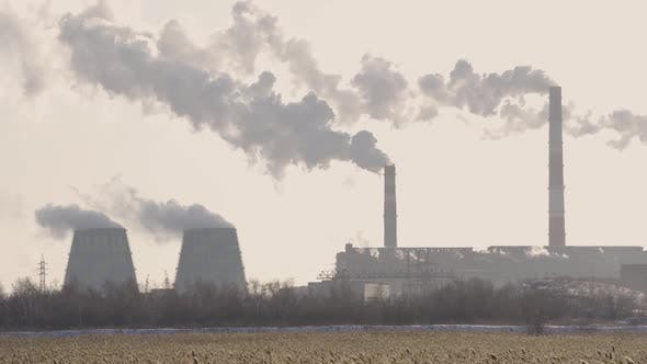 the Power Plant Emits Smoke and Pollutes the Environment