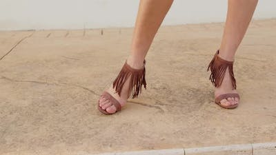 close up woman foot with summer shoes
