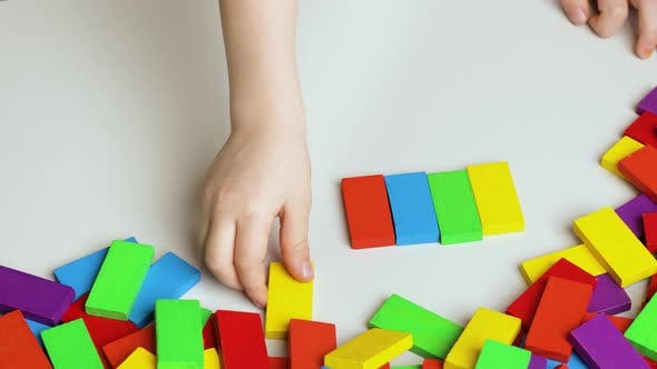 Thumbnail for Girl Plays with Colorful Blocks.