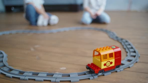 Cover Image for Kids Play with Wooden Railway. Child with Toy Train. Educational Toys for Young Children. Little Boy