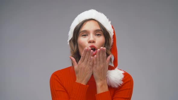 Woman in Santa Helper Hat Dancing on Christmas