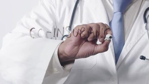 Asian Doctor Writing Co Insurance