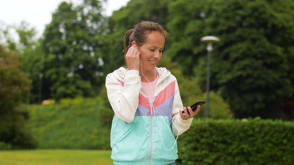 Thumbnail for Woman Listening To Music on Smartphone at Park
