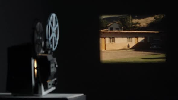 Thumbnail for Film projected onto wall playing old film