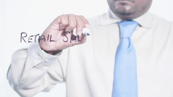 Asian Businessman Writes Retail Sales