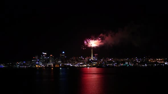Firework from Sky Tower in Auckland ending with a big explosion of fireworks