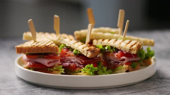 Plate with Multiple Tasty and Fresh Club Sandwiches
