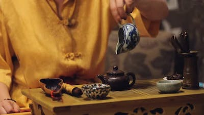 Female Hands Putting Herbal Leaves in Teapot, Performing History Art Traditions