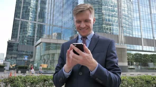 Thumbnail for Businessman Using Smartphone Text Messaging