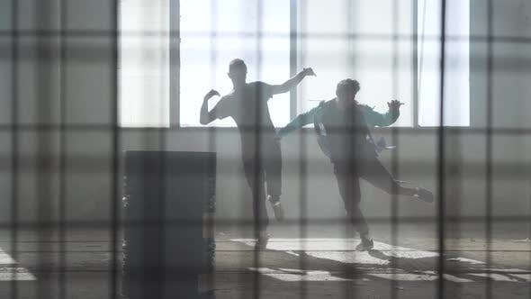 Thumbnail for Two Friends Dance Synchronously Hip Hop Modern in an Abandoned Building