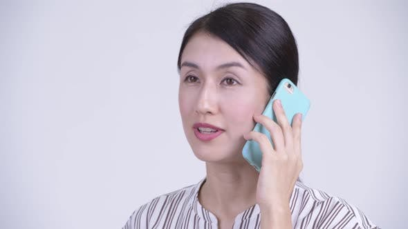 Thumbnail for Face of Happy Beautiful Asian Businesswoman Talking on the Phone