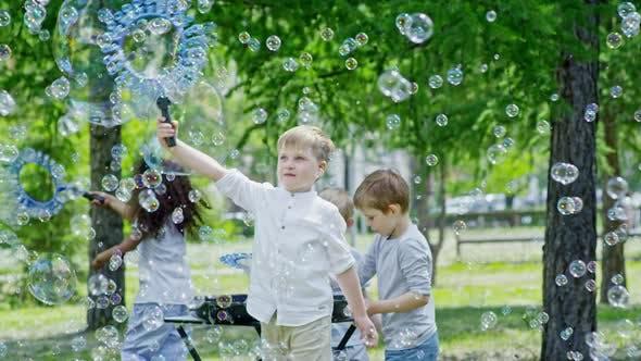 Thumbnail for Joyous Children Having Fun while Blowing Soap Bubbles