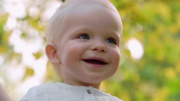 Thumbnail for Close up of Blond Baby Smiling at Parents