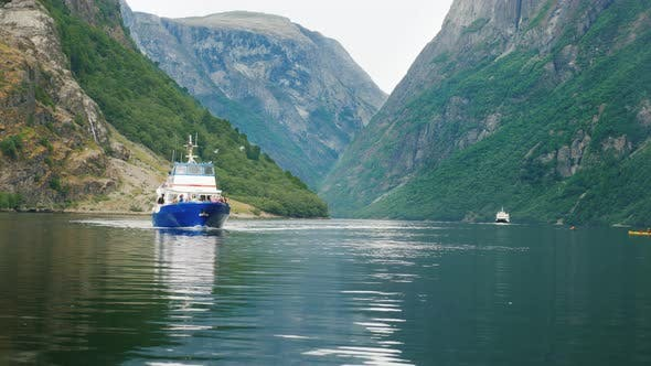 Thumbnail for A Small Cruise Ship Sails Along the Picturesque Fjord in Norway