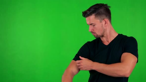 Thumbnail for Young Handsome Caucasian Man Adjusts Clothes and Smiles To Camera - Green Screen