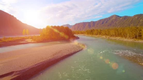Thumbnail for Low Flight Over Fresh Cold Mountain River at Sunny Summer Morning