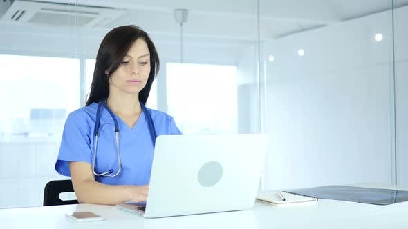Thumbnail for Female Doctor Typing on Laptop in Hospital