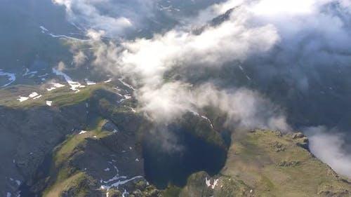 Aerial Cloudy Mountain Lake