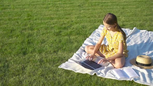 Thumbnail for Little Girl Outdoors in the Park with Computer
