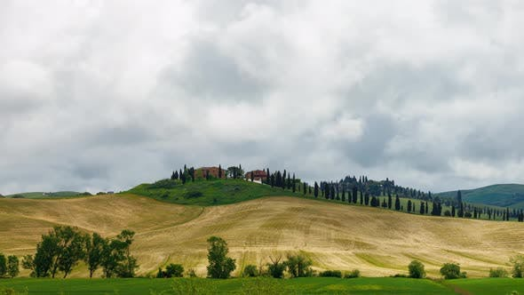 Time Lapse of the clouds over the rolling hills of Tuscany Italy