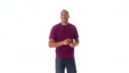 African-American man facing camera and dancing