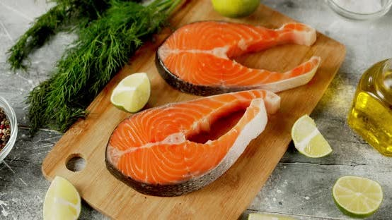 Raw Pieces of Salmon with Lime and Spices Rotate