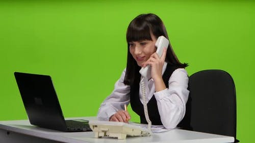 Girl Administrator Answers the Phone Call and Makes Notes