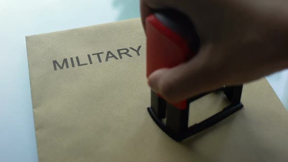 Military Report Classified, Stamping Seal on Folder With Important Documents