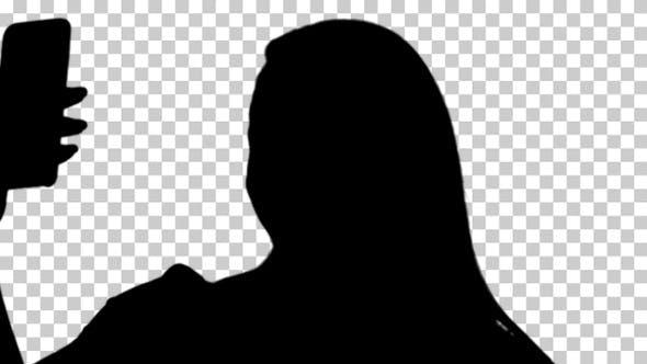 Silhouette girl taking a selfie, Alpha Channel