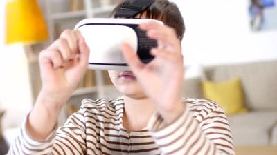 Schoolboy in VR Glasses