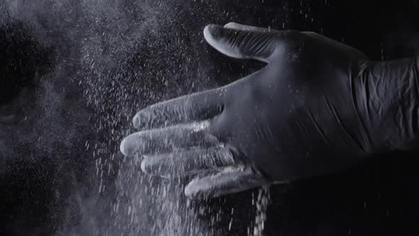 Thumbnail for Close Up Of A Chef Wiping Flour From Hands