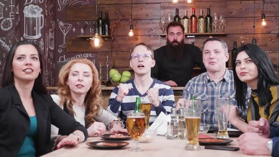 Thumbnail for Group of Friends Watch a Sport Game on a TV in a Vintage Pub