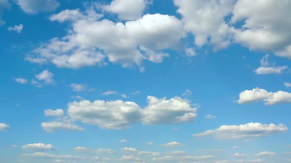 Cover Image for Beautiful White Clouds Floating At The Blue Sky On A Sunny Day
