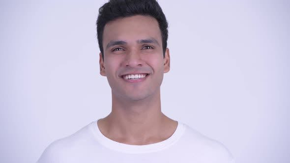 Thumbnail for Face of Happy Young Handsome Indian Man Smiling