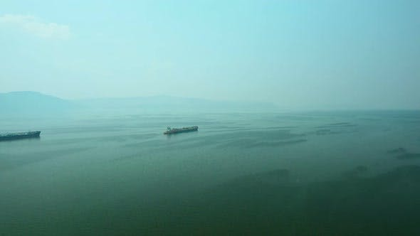 Thumbnail for Aerial View, Cargo Barges Sailing Into the Sea. Cargo Ships Sail Across the Endless Sea.