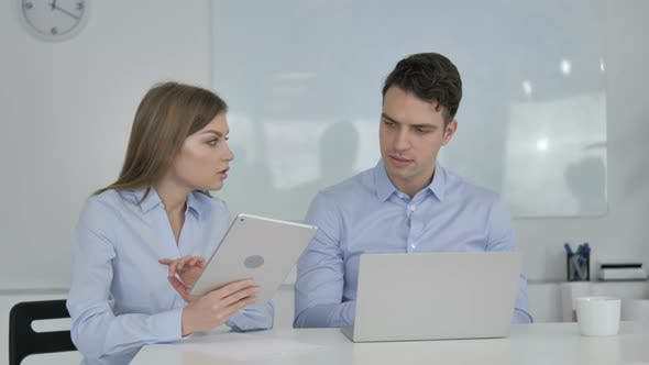 Thumbnail for Sharing Opinions, Business Colleagues Using Tablet and Laptop During Work