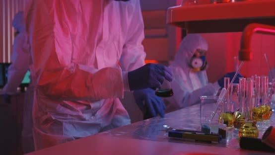 Thumbnail for Scientists Sitting and Working in Laboratory