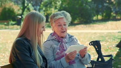 Old Woman Showing Her Pretty Granddaughter a Letter